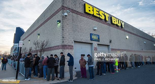 Customers line up waiting for the doors to open at a Best Buy store in Fairfax Virginia on November 26 on a Black Friday sale that started a day...