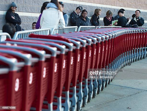 Customers line up waiting for the doors to open at a Target store in Fairfax Virginia on November 26 on a Black Friday sale that started a day...