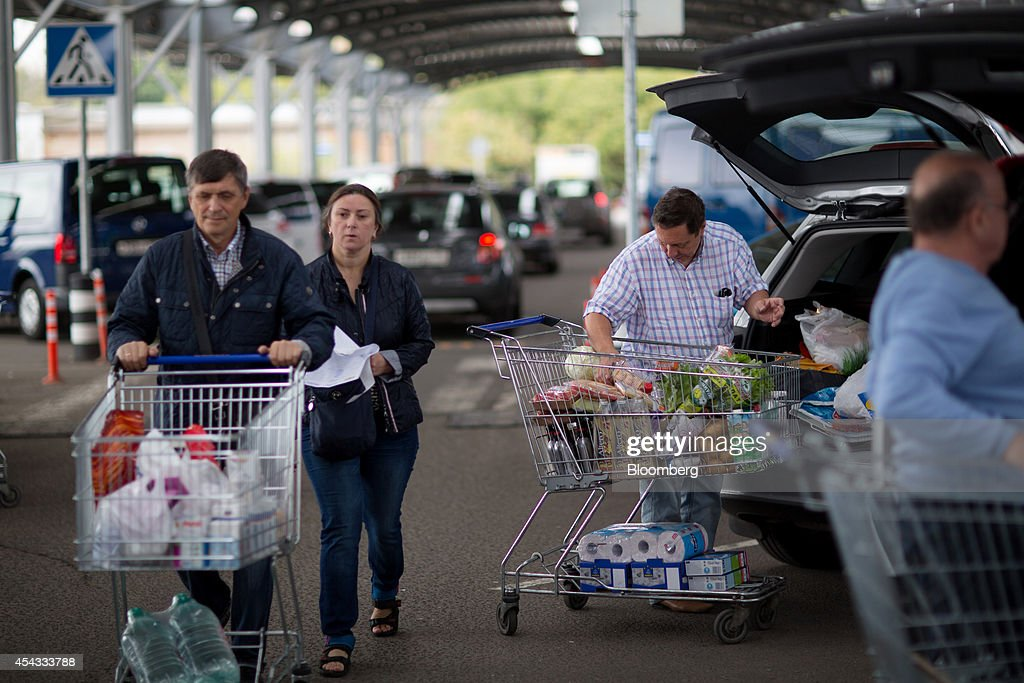Customers load their vehicles with products after shopping at a Metro Cash & Carry store, the Russia unit of Metro AG, in Moscow, Russia, on Friday, Aug. 29, 2014. Metro Cash & Carry has warned that domestic food suppliers are trying to increase some food prices as local produce is substituted for EU, Norwegian and U.S. equivalents which have been sanctioned. Photographer: Andrey Rudakov/Bloomberg via Getty Images