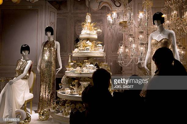 Customers look at a christmas themed shop front display on November 28 in Paris at the Printemps department store AFP PHOTO JOEL SAGET