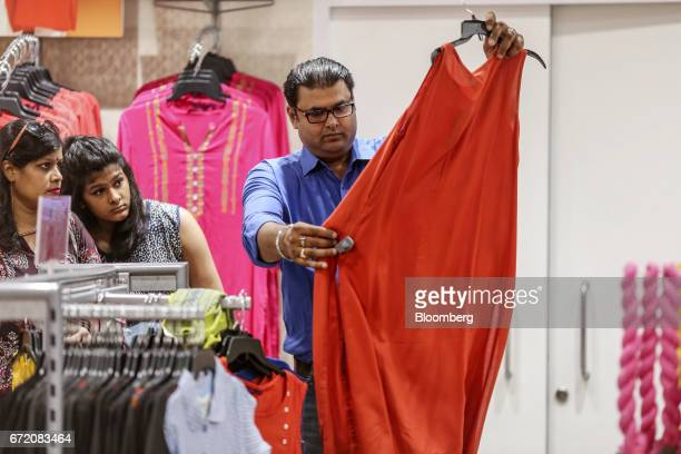 Customers look at a dress at a Big Bazaar hypermarket operated by Future Retail Ltd in Mumbai India on Sunday April 16 2017 Future Retail India's...