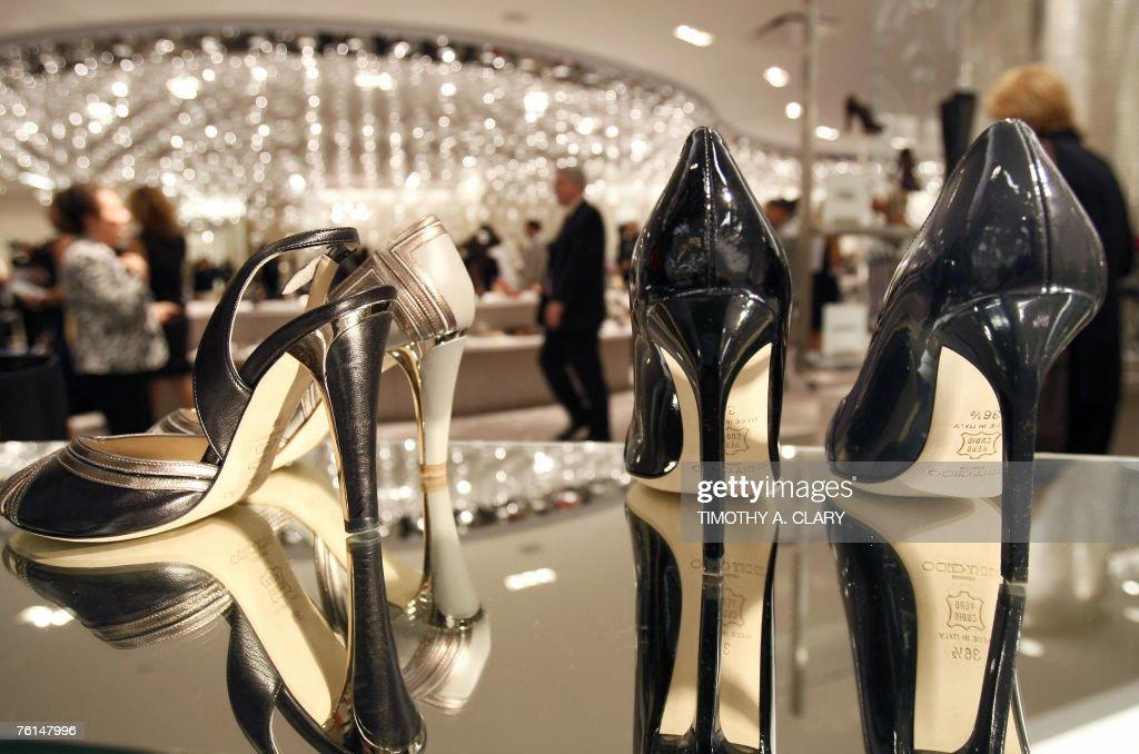 5b1fa879702 Customers look at a pair of Jimmy Choo heels as Saks Fifth Avenue ...
