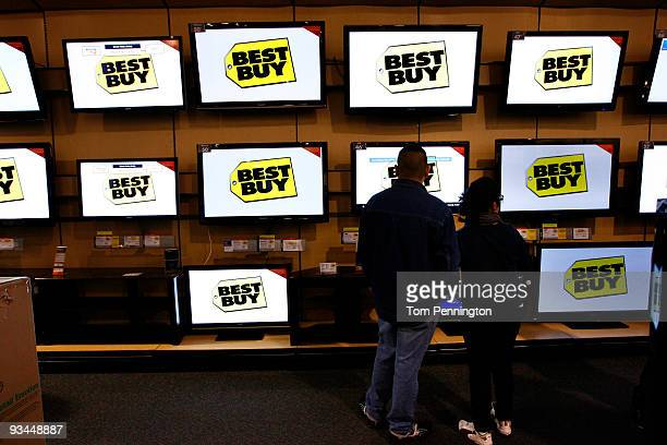 Customers look at a selection of plasma flat screen television sets at Best Buy electronics store on November 27 2009 in Fort Worth Texas According...