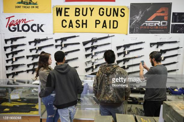 Customers look at AR-15 rifles at a store in Orem, Utah, U.S., on Thursday, March 25, 2021. Two mass shootings in one week are giving Democrats new...