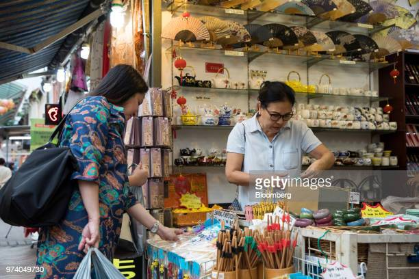 Customers look at chopsticks at a stall in the Chinatown area of Singapore on Wednesday June 13 2018 Tourism as well as the consumer sector will...