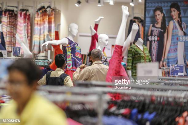 Customers look at clothes displayed on mannequins at a Big Bazaar hypermarket operated by Future Retail Ltd in Mumbai India on Sunday April 16 2017...
