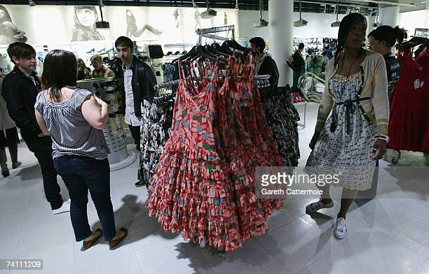 Customers look at clothing during the public launch of the 'Lily Loves' collection at the New Look store on Oxford Street on May 09 2007 in London...