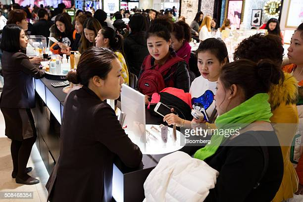 Customers look at cosmetic products at a Hotel Lotte Co Duty Free store in Seoul South Korea on Thursday Feb 4 2016 Hotel Lotte the lodgings and...