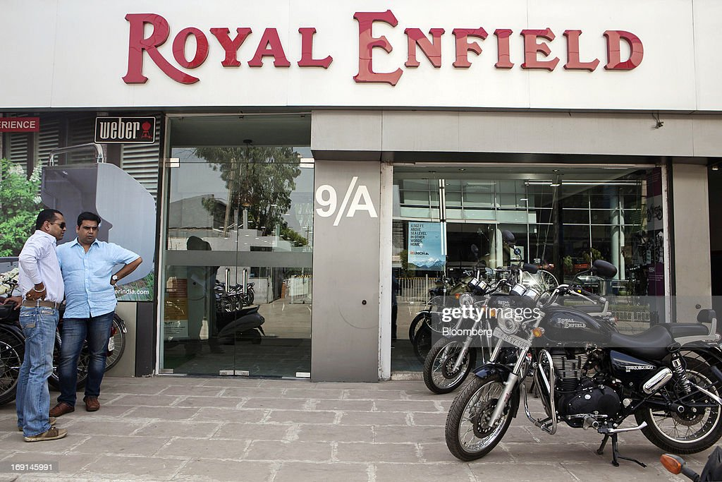 Customers look at Eicher Motors Ltd. Royal Enfield Thunderbird 500 motorcycles on display outside the Royal Enfield flagship dealership in Gurgaon, India, on Monday, May 20, 2013. The Indian maker of Royal Enfield, the World War II-era British motorcycle owned by stars including Brad Pitt, plans to export the vehicles to Southeast Asia and Latin America as it builds on record sales at home. Photographer: Prashanth Vishwanathan/Bloomberg via Getty Images