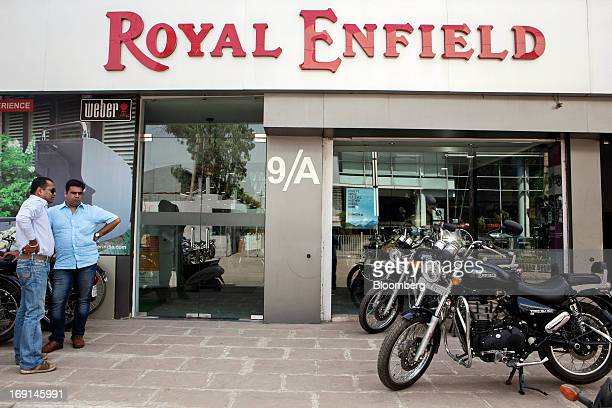 Customers look at Eicher Motors Ltd. Royal Enfield Thunderbird 500 motorcycles on display outside the Royal Enfield flagship dealership in Gurgaon,...
