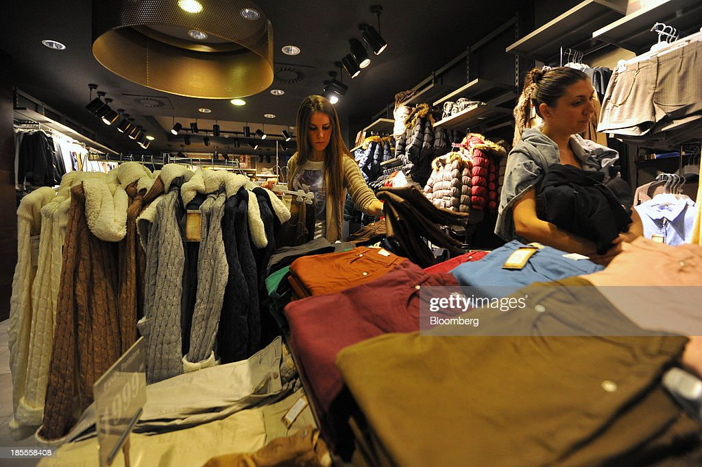 Customers look at items of women's fashion clothing inside a Calliope store in Belgrade, Serbia, on Monday, Oct. 21, 2013. Serbia's government revealed a salvo of measures to bring the public finance deficit and debt back under control by 2017 after the head of the largest coalition party warned the country was on the brink of insolvency. Photographer: Oliver Bunic/Bloomberg via Getty Images