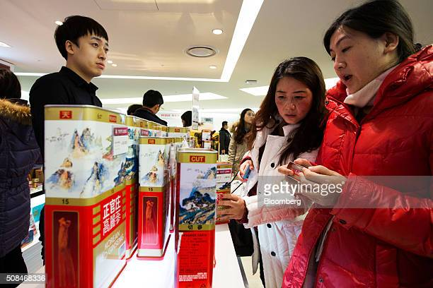 Customers look at Korea Ginseng Corp's Cheong Kwan Jang branded ginseng products at a Hotel Lotte Co Duty Free store in Seoul South Korea on Thursday...
