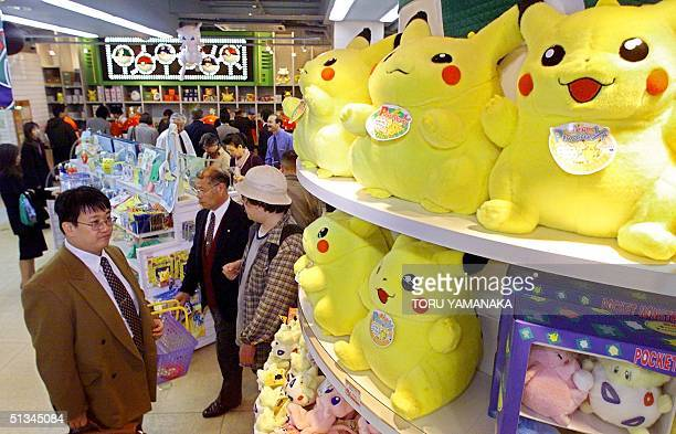 Customers look at 'Pokemon' TV cartoon character goods at the Pokemon Center in downtown Tokyo 21 November 1999 A killer earthquake occurred in...