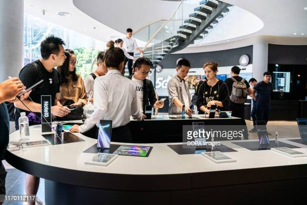 Customers look at Samsung Galaxy Note 10 5G smartphones at a Samsung store in Shanghai