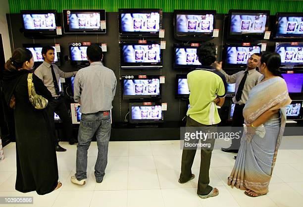 Customers look at televisions at Vijay Sales in Mumbai India on Tuesday Sept 7 2010 Consumers in India are set to spend record amounts on gold...