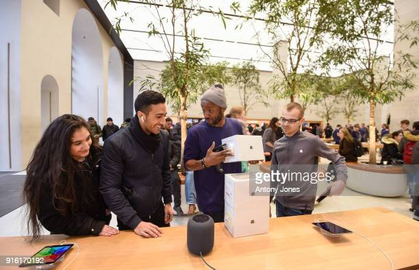 Customers look at The Apple HomePod which is now available in stores in the US UK and Australia at Apple Store on Regent Street on February 9 2018 in...