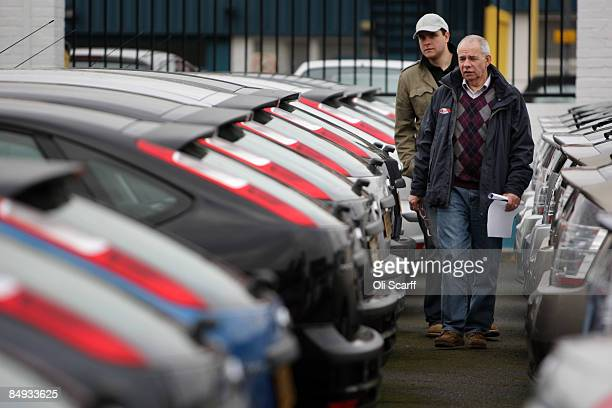 Customers look at the cars on sale at Cargiant the world's largest car supermarket in White City on February 18 2009 in London The Cargiant site on...