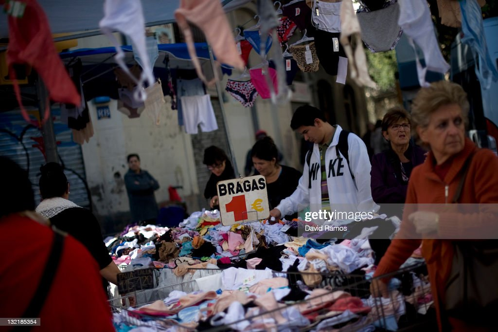 Customers look for a one Euro underwear at a second hand market on November 9, 2011 in Barcelona, Spain. The current Eurozone debt crisis has left Spain with crippling economic problems. Mounting debts, record unemployment figures and the recent credit rating downgrade is leaving the country facing further economic stagnation. The people of Spain are preparing to go to the polls for a general election which will be held on November 20, 2011.