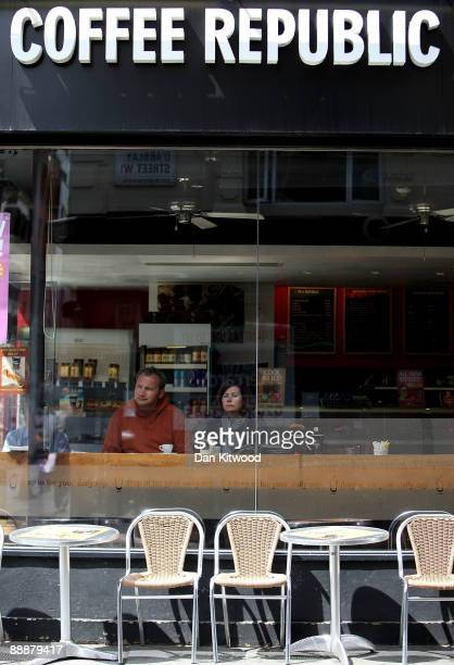 Customers look on while having a drink in a Coffee Republic in Soho on July 7, 2009 in London, England. The high street coffee chain has collapsed...
