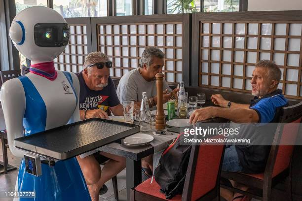 Customers look the robot waiter on July 25 2019 in Rapallo Italy The Gran Caffè Rapallo restaurant in Liguria is the first restaurant in Italy to use...