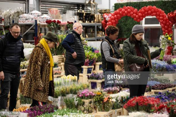 Customers look through flowers on display at New Covent Garden Flower Market ahead of Valentine's Day on February 13 2018 in London England New...
