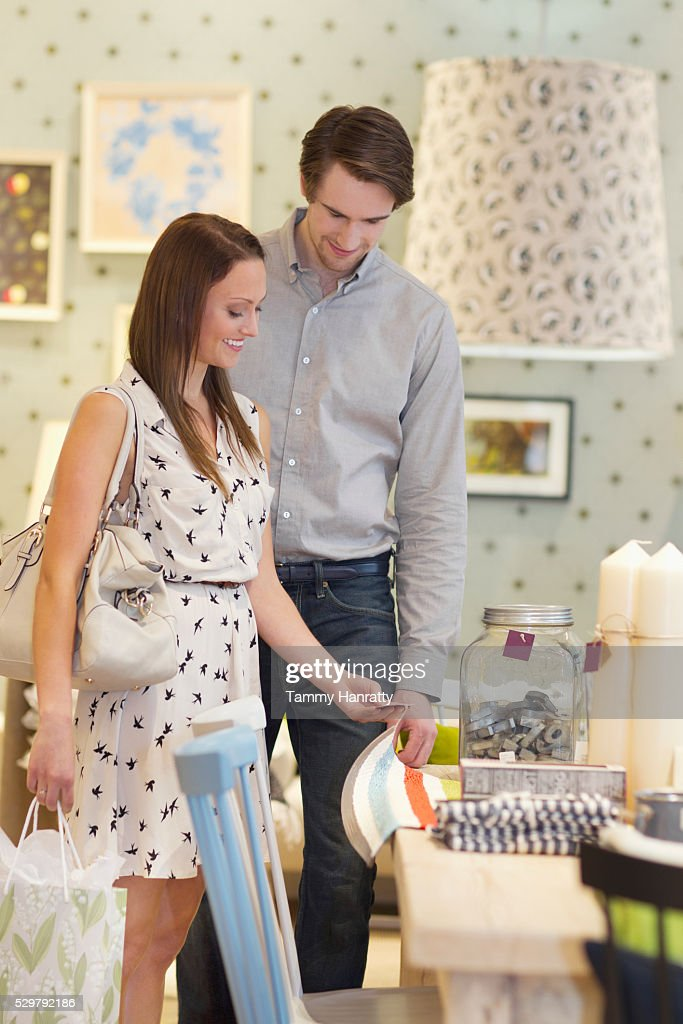 Customers looking at price tag : Stock Photo