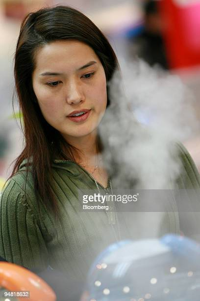 A customers looks at an air humidifier in a Gome Electrical Appliance store in Beijing China on January 21 2006 Huang Guangyu became China's youngest...