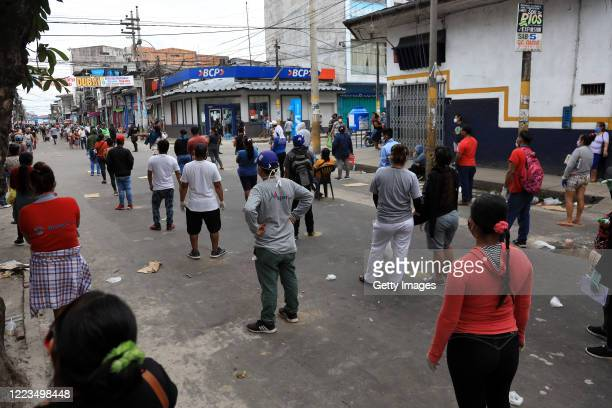 Customers make a line observing social distance to enter Belén Market on May 06, 2020 in Iquitos, Peru. Iquitos, capital city of the largest province...