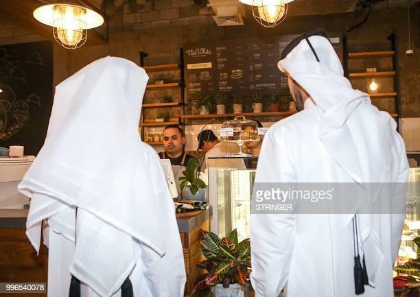 Customers make an order at the 'Flat White' cafe in the Qatari capital Doha's Tawar Mall on June 8 2018 Tawar Mall looks like any of Qatar's...