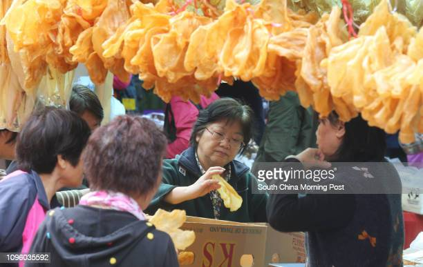 Customers make choice of dried fish maw during opening ceremony for FarmFest 2016 at Fa Hui Park Mong Kok 09JAN16 SCMP/Dickson Lee