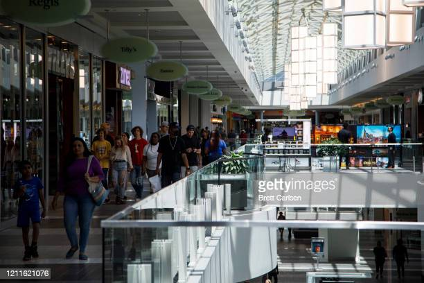 Customers make their way through CoolSprings Galleria shopping mall despite many retail locations inside the mall remaining closed on May 2 2020 in...