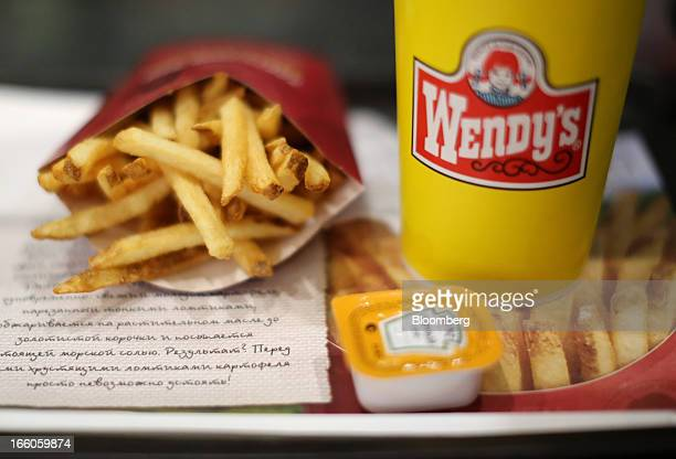 A customer's meal of French fries and a soft drink sit on a tray inside a Wendy's fast food restaurant in Moscow Russia on Friday April 5 2013...