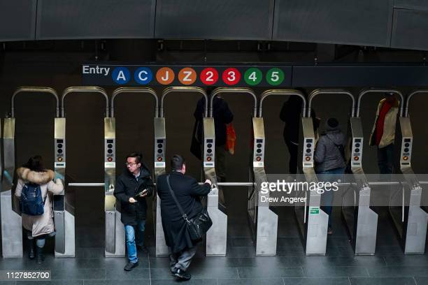 Customers move through the turnstiles at the Fulton Center subway station, February 27, 2019 in New York City. On Wednesday, the Metropolitan...