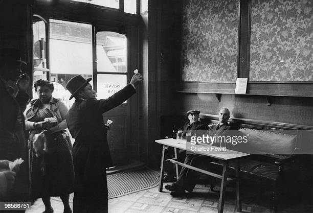 Customers of different ethnic origins in a bar in Brixton, south London, 1952. Original Publication : Picture Post - 6044 - Breeding A Colour Bar? -...