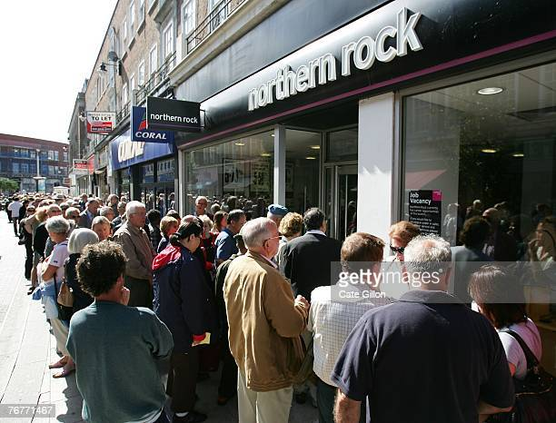 Customers of Northern Rock queue outside the Kingston branch of the company on Castle Street, in order to take their money out of their accounts on...