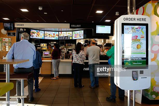 Customers order food from a service counter inside a McDonald's Corp restaurant in Manchester UK on Monday Aug 10 2015 McDonald's Chief Executive...