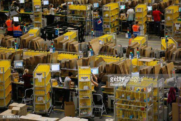 Customers' orders are processed at an Amazoncom Inc fulfillment center in Peterborough UK on Wednesday Nov 15 2017 As Amazon's share of retail sales...