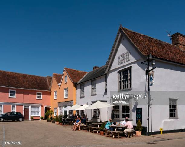 customers outside the angel hotel in the market place, lavenham, suffolk - lavenham stock photos and pictures