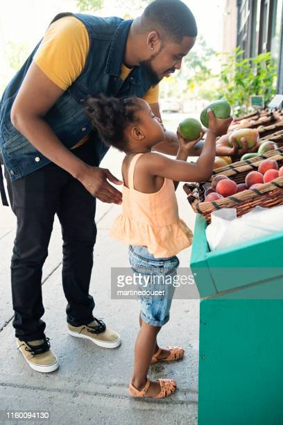 Customers outside zero waste oriented fruit and grocery store.