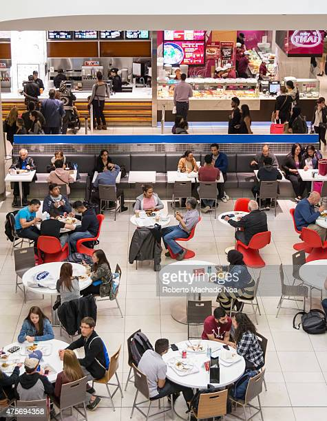 Customers pack a busy mall food court