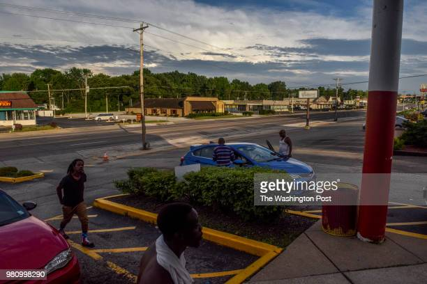 Customers pass in and out of Sams Meat Market on W Florissant Avenue in southeast Ferguson on Tuesday May 29 in Ferguson MO The liquor store that...