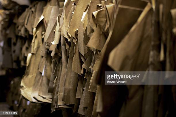 Customers patterns hang in the basement of Huntsman tailors on August 14, 2006 in London, England. With the commercial expansion of nearby tourist...