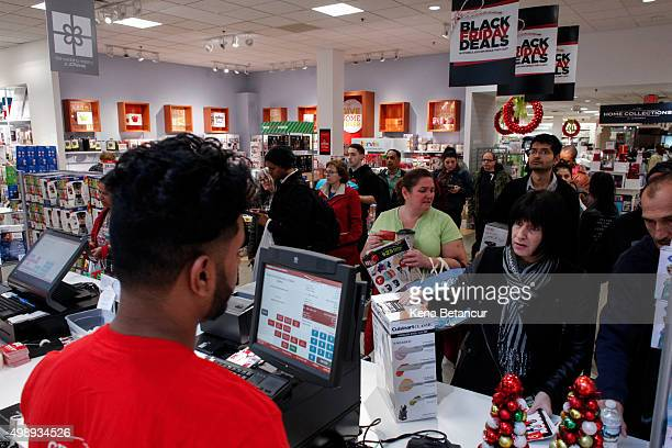 Customers pay at a cashier station in a JCpenny Store at the Newport Mall during Black Friday Sales on November 27 2015 in Jersey City New Jersey It...