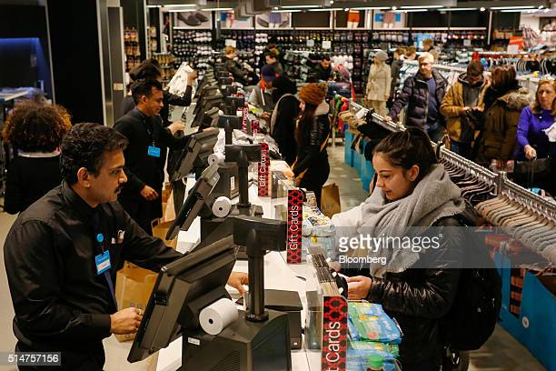Customers pay employees at the checkout desks of a Primark clothing store operated by Associated British Foods Plc on Oxford Street in London UK on...