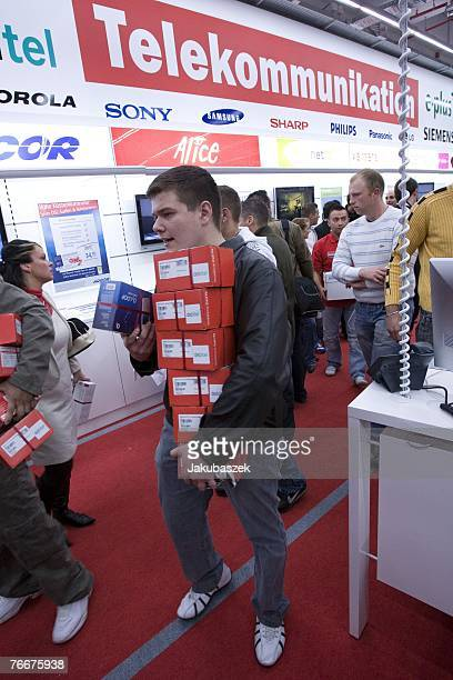 Customers pick up sales items at the newest branch of the electronic shopping center Mediamarkt at the shopping mall Alexa September 12 2007 in...