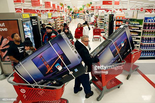 Customers pick up shopping carts containing Element Electronics 50inch lightemitting diode high definition televisions at a Target Corp store opening...