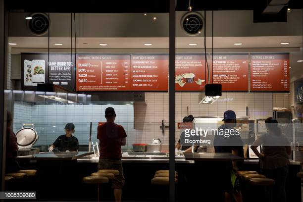 Customers place orders inside a Chipotle Mexican Grill Inc restaurant in Culver City California US on Tuesday July 24 2018 Chipotle is scheduled to...