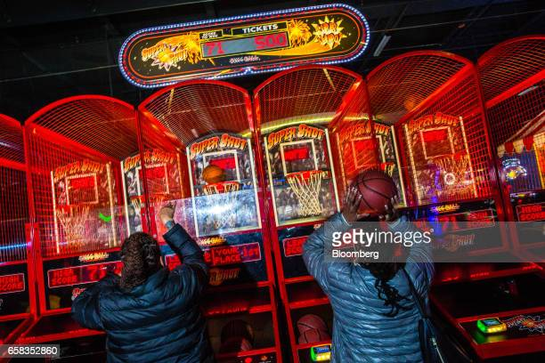 Customers play a basketball arcade game at a Dave & Buster's Entertainment Inc. Location in Pelham, New York, U.S. On Friday, March 24, 2017. Dave &...