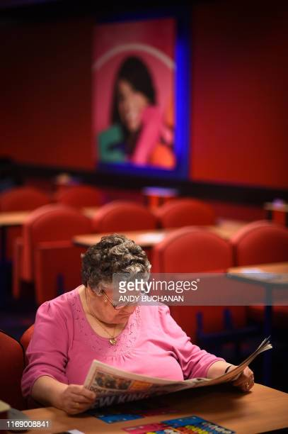 Customers play bingo at the MECCA Bingo Hall in the East End of Glasgow Scotland on August 15 2019 Historically beloved by British grandmothers the...