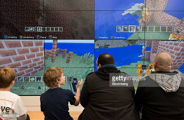 Customers play the Minecraft video game during the opening of the first Microsoft Corp store in New York US on Monday Oct 26 2015 In the making for...